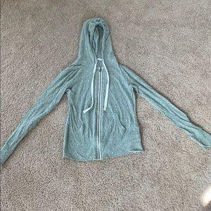 Green zip up light sweatshirt with hood